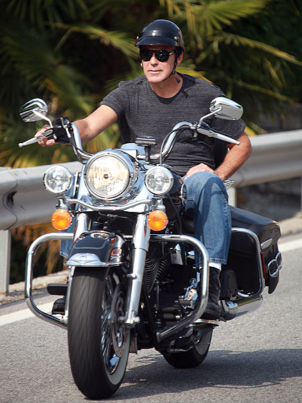 A MOTORCYCLE photo | George Clooney