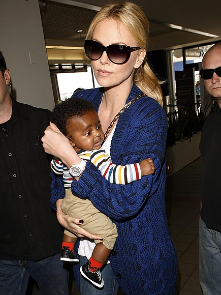 CUTE CARGO  photo | Charlize Theron