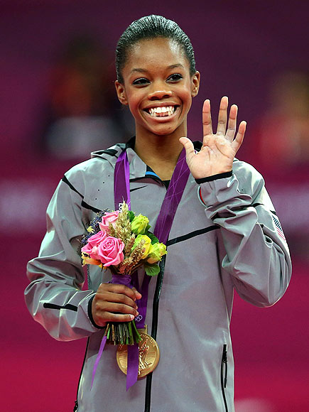 SHOWING HER MEDAL photo | Gabrielle Douglas