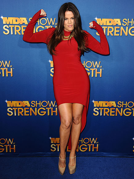 STRONG-ARMING IT photo | Khloe Kardashian
