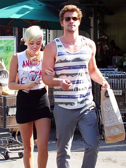 ARM CANDY photo | Liam Hemsworth, Miley Cyrus