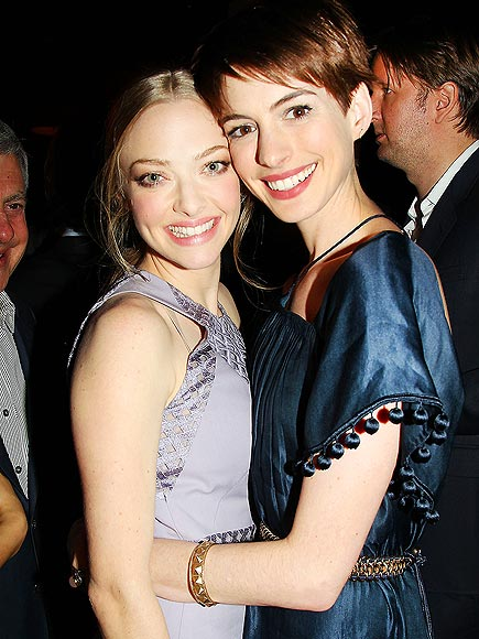 COSTAR CUDDLE photo | Amanda Seyfried, Anne Hathaway