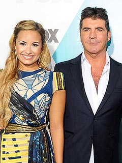 The X Factor Showdown: Would You Rather Take Advice from Simon Cowell or Demi Lovato?