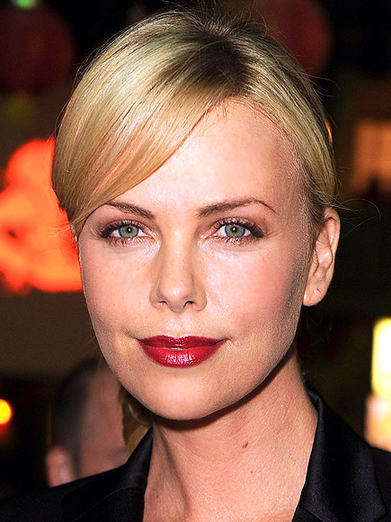 DEEP RED LIPS WITH MINIMAL MAKEUP photo | Charlize Theron