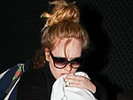 PHOTO: Adele Arrives (with Baby!) in L.A. for the Golden Globes