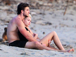 PHOTO: Miley & Liam Cuddle on the Beach in Costa Rica | Liam Hemsworth, Miley Cyrus