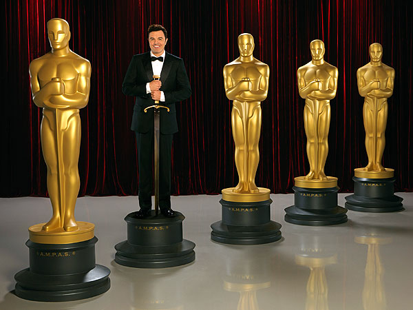PHOTO: Seth MacFarlane Lets Popcorn Fly in New Oscar Promo| Academy Awards, Oscars 2013, TV News, Seth MacFarlane