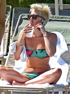 Miley Cyrus Lounges In Bikini As Split From Liam Hemsworth Rumors Swirl