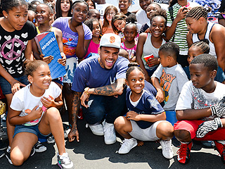 Why Is Chris Brown Handing Out 1,000 Sneakers? | Chris Brown