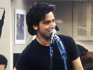 You'll Never Guess Who John Stamos Is Performing with This Week