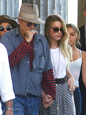 Johnny Depp & Amber Heard Both Sport Stripes in Berlin