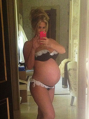 Kim Zolciak and Her Double-Bump Hit the Pool in a Bikini