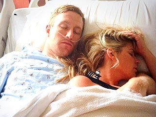 PHOTO: Pregnant Kim Zolciak Naps with Injured Husband in Hospital Bed