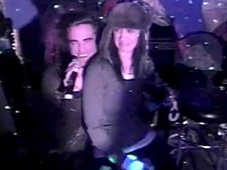 Watch This: Katy Perry Sits on Robert Pattinson's Lap, Sings Karaoke