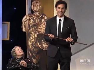 Stunt or Slip? See Sacha Baron Cohen's Award Show Fumble