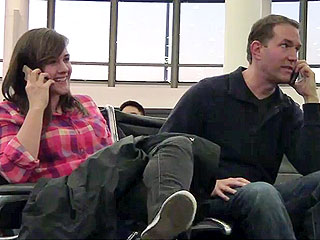 Watch Man Join Strangers' Phone Conversations in Epic Airport Prank