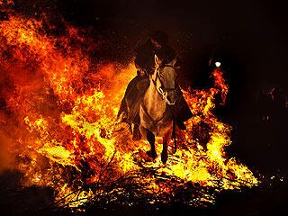 PHOTO: Horses Ride Through Fire for Spanish Festival