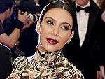 Kim Kardashian Makes Met Gala Debut in Floral Dress with Attached Gloves