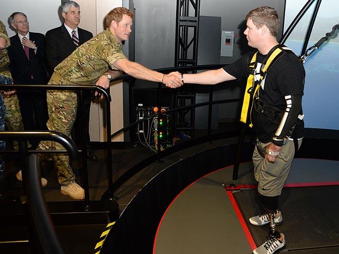 EXTENDING A HAND photo | Prince Harry