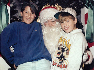 Two Brothers Take Adorable Pictures with Santa 34 Years in a Row
