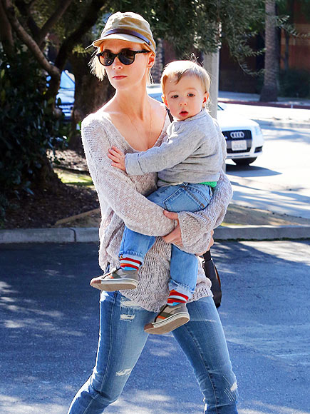 ADORABLE ARMFUL photo | January Jones