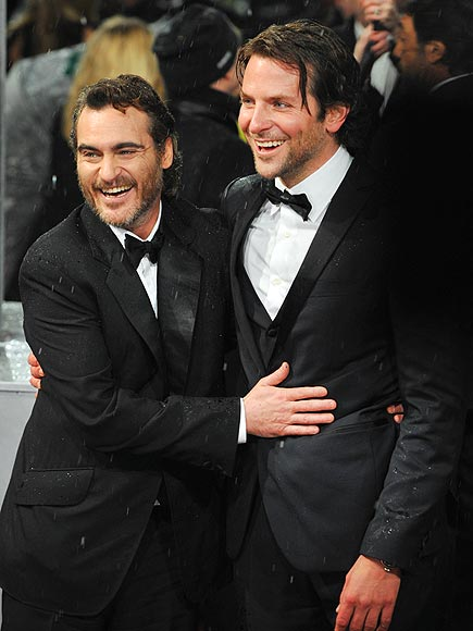 TOUCHING MOMENT photo | Bradley Cooper, Joaquin Phoenix
