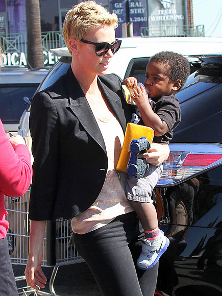TAKING IT IN STRIDE photo   Charlize Theron