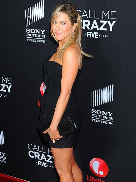 A LEG UP photo | Jennifer Aniston