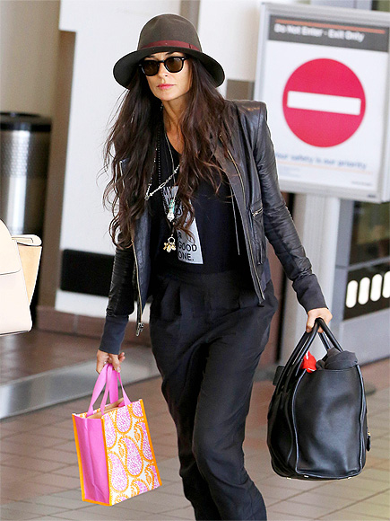 FREQUENT FLYER photo | Demi Moore