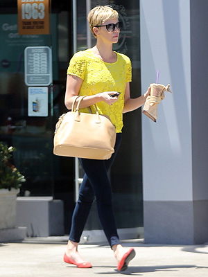 Charlize Theron yellow shirt