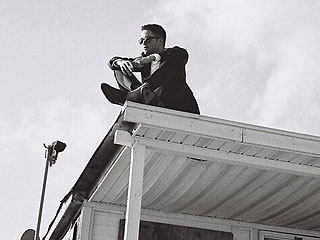 Why Is Robert Pattinson Sitting on a Roof?