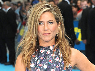 We're Feeling Faint: Jennifer Aniston Wears Florals and Bold Gems to an Event | Jennifer Aniston