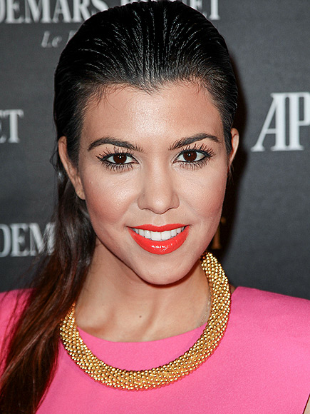 SLICKED-BACK HAIR photo | Kourtney Kardashian
