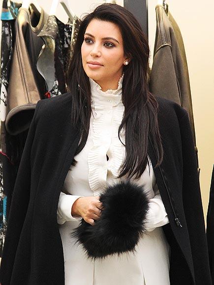 FURRY CLUTCHES photo | Kim Kardashian