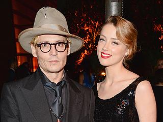 Johnny Depp Is 'Lovestruck' by Amber Heard, Friends Say