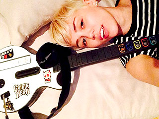 Watch Miley Cyrus Rock Out on Guitar Hero