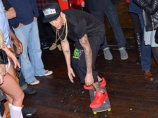 Justin Bieber Partied on Skateboard at a Pre-Super Bowl Bash