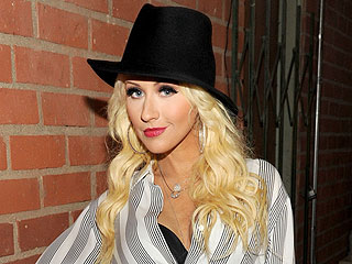 Pregnant Christina Aguilera 'Glowing' at Miley Cyrus Concert
