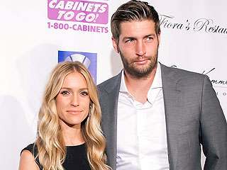 Pregnant Kristin Cavallari Hits the Beach in Strappy Bathing Suit