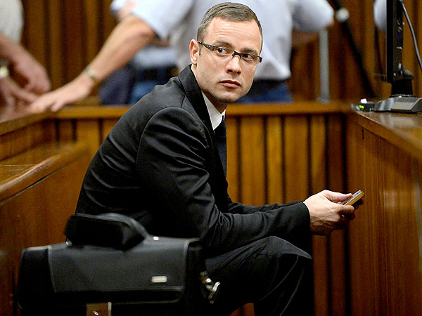 Oscar Pistorius Murder Trial: Photos of a Bloodied Blade Runner Shown in Court