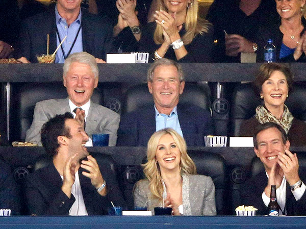Presidents Bill Clinton and George W. Bush Catch the NCAA College Basketball Finals Together