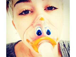 Quack! Miley Cyrus Wears Duck-Face Oxygen Mask as Tour Is Postponed