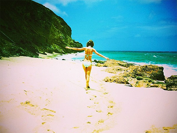 Taylor Swift Cavorts on a Tropical Beach in a Bikini
