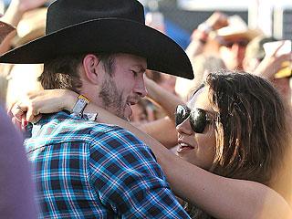 PHOTO: Ashton Kutcher and Mila Kunis Get Lovey-Dovey at Stagecoach Festival