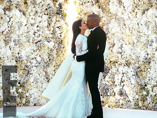 See Kim and Kanye West's First Kiss as a Married Couple