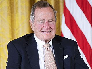 President George H.W. Bush Makes Parachute Jump for 90th Birthday