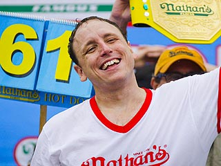 Joey Chestnut Wins Hot Dog Eating Contest – and Fiancée
