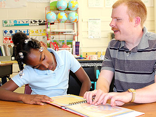 Heroes Among Us: Blind YMCA Volunteer Teaches Children How to Read