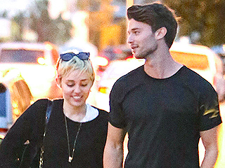 PHOTO: Miley Cyrus & Patrick Schwarzenegger Snuggle Up on Dinner Date