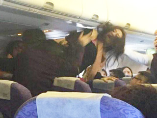 Airplane Brawl over Crying Baby Nearly Causes Emergency Landing